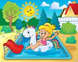 Girl floating on inflatable unicorn 3