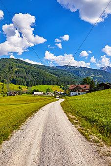 Austria country road among picturesque austrian landscapes