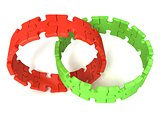 Two red and green puzzle rings, isolated