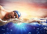 Boy swims in a blue deep water