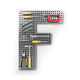 Letter F. Alphabet from the tools on the metal pegboard isolated