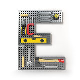 Letter E. Alphabet from the tools on the metal pegboard isolated