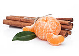 Fresh organic mandarin fruit with raw cinnamon