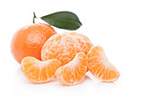 Fresh organic peeled mandarin fruit with leaves