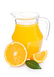 Glass jar of fresh orange juice with fruits