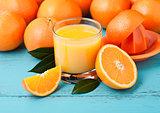 Glass of organic fresh orange juice with fruits