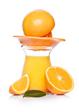 Fresh raw peeled oranges with juice squeezer jar