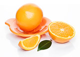 Fresh raw peeled oranges with juice squeezer