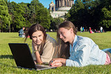 Two girls in the park with a laptop