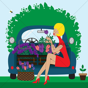 Blue car with pretty lady with flowers.