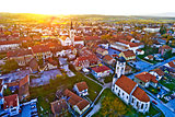 Colorful sunset above medieval town of Krizevci aerial view