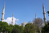 Blue Mosque at Sunny Day in Istanbul, Turkey on the Background of Trees, Blue Sky and Clouds