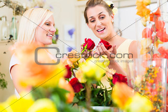 Women in the flower store buying roses