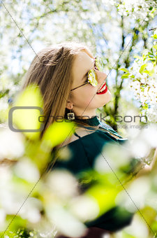 Beautiful happy girl in the spring in the fresh air