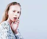 young pretty stylish blond hipster girl posing emotional isolate