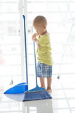 Young kid sweeping floor