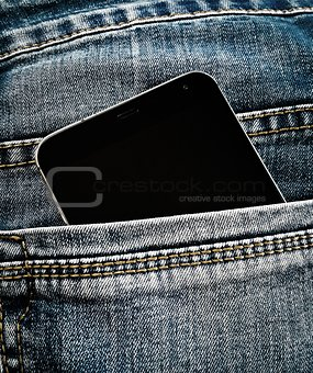 Smartphone in the jeans pocket