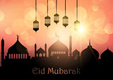 Eid Mubarak background with hanging lanterns and mosque silhouet