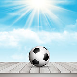 Football / soccer ball on table against blue sky