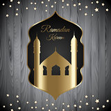 Ramadan Kareem background with mosque silhouette on wood texture