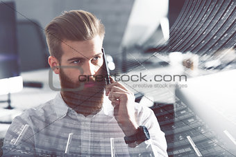 Businessman talking to the phone in office. double exposure