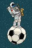 Astronaut plays saxophone on a football soccer ball