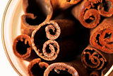 Cinnamon isolated on wood background