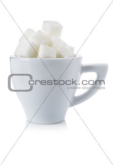 Cubes of white sugar in a white cup