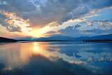 Incredibly beautiful sunset.Sun, sky,lake.Sunset or sunrise landscape, panorama of beautiful nature. Sky with amazing colorful clouds.