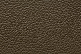 Contrast leather background in dark grey colour.