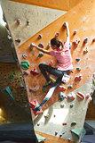 woman climber climbs indoors