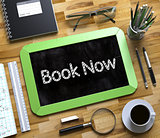 Book Now - Text on Small Chalkboard. 3d