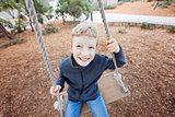 kid at swings