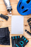 set of objects for cycling and a sheet of paper for inscription