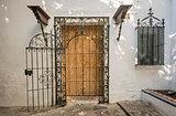 Ancient wooden door with iron bars in Sevilla, Spain