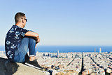 young man with Barcelona, Spain, below him