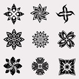 The vector set of heraldic decoration flowers