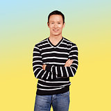 Asian man in striped pullovert