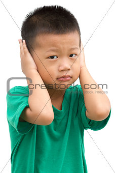 Asian child covered his ears