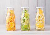 Bottles with oranges with limes and lemons slices
