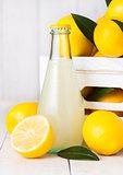 Glass bottle of organic fresh lemon juice fruits