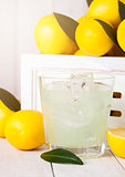 Glass of organic fresh lemon juice with fruits