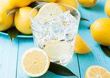 Glass of organic fresh lemon still summer water