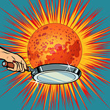 People with a frying pan fry the planet Mars