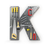 Letter K. Alphabet from the tools on the metal pegboard isolated