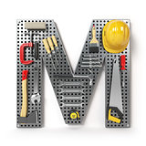 Letter M. Alphabet from the tools on the metal pegboard isolated