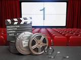 Cinema, movie or home video concept background. Film reels and c