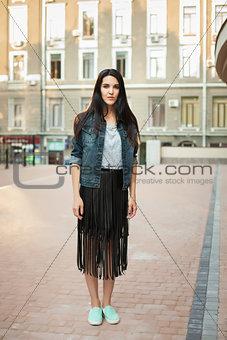 young girl walking around city