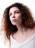 Close-up portrait of beautiful young woman with curly hair