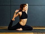 Redhead woman doing yoga stretches